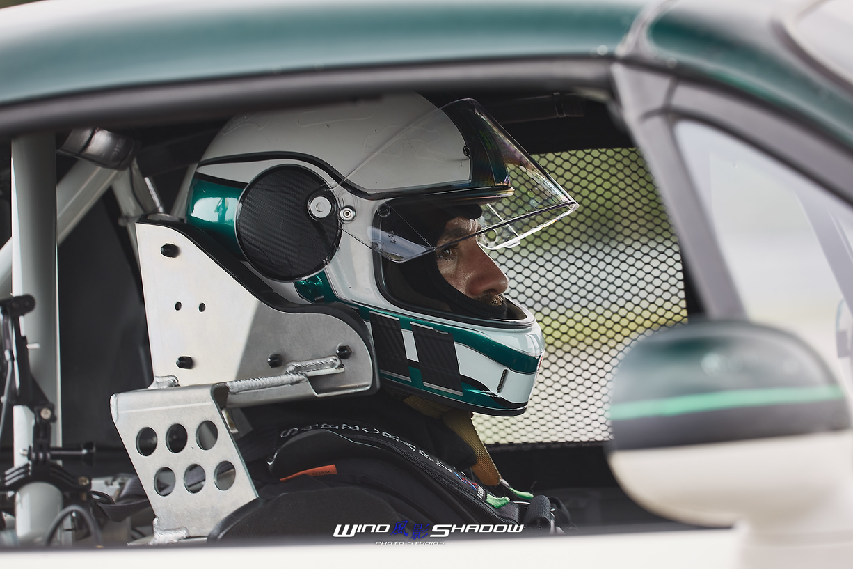 Race Driver waiting in grid to go on track. Windshadow Photos