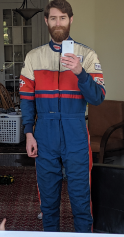Used vintage racing suit cheap but safe. Red white and blue